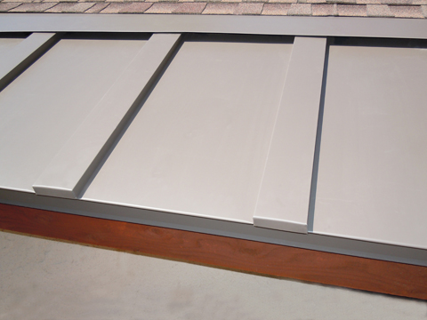 Heated standing seam metal roofing to prevent ice dams