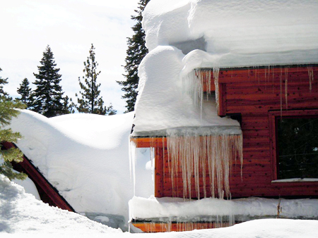 Ice dam and icicles form and damage roofs and leak.