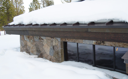 eave ice melt on slow slope low pitch roof